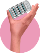 woman's hand holding a 4-pack of joy shaving razor refills