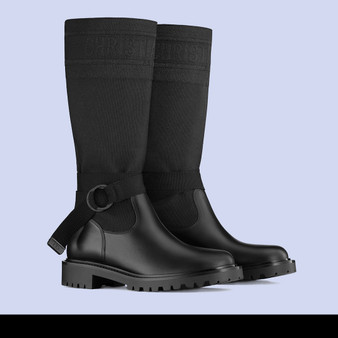 Cover photo of a Dior D-Major Boot. Crafted from black technical fabric. Featuring a bicolor 'Christian Dior' signature at the top, a 'CD' signature adjustable nylon belt and crimped rubber sole