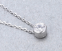 Elegant Look Classic Moissanite Pendant - Round Cut Design, Close-up shot