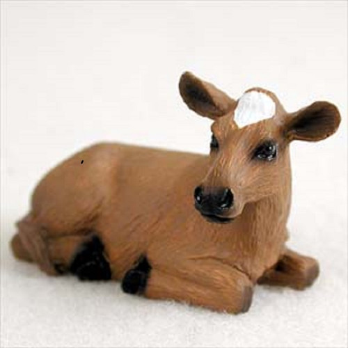 small guernsey cow figurine