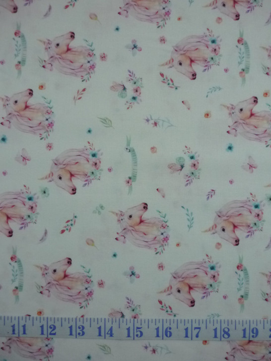 A Magical Time Unicorns and Butterflies White Background Cotton Quilting Fabric 1/2 YARD