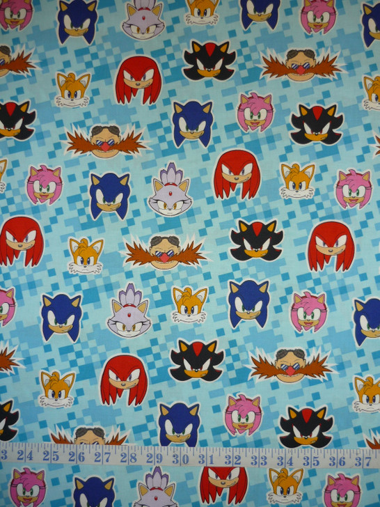 Sonic the hedgehodge Faces Toss Blue Background Cotton Quilting Fabric