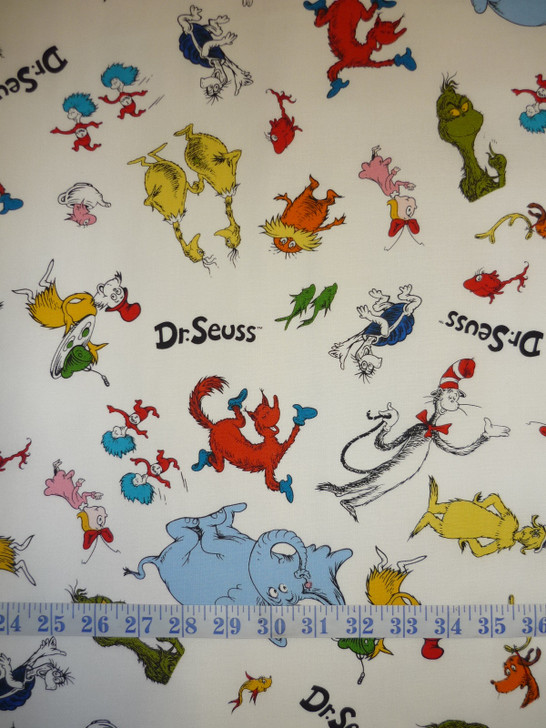Celebrate Seuss Character Toss White Background Cotton quilting Fabric