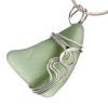 A pale olivegreen sea glass set in our signature Waves setting. This is an updated version of our popular and secure Squiggles setting. Genuine beach found sea glass UNALTERED from the way it was found on the beach!