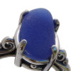 Detail of blue sea glass in the ring.