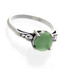 A natural sea glass piece is in this ring. We actually sort through thousands of pieces of sea glass to find the perfect fit for our ring bases.