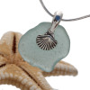 A stunning piece of vivid genuine aqua sea glass from Scotland is set on a professionally hand cast solid sterling bail and finished with a sterling shell charm. the 18 Inch SOLID STERLING snake chain (shown) IS INCLUDED!