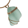 This is authentic natural sea glass in an vivid seafoam green color! We have set this in a simple triple gold setting that maximizes the gold yet leaves a corner of the glass open so you can reach up an feel the great texture of the Certified Genuine Sea Glass.
