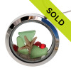 Green sea glass is combined with two real starfish and vivid red gemstones for a holiday inspired sea glass locket. Sorry this piece has been sold!