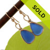 It can takes HUNDREDS and HUNDREDS of pieces of natural blue sea glass to match for a pair of perfect earrings.  Our Original Wire Bezel© earring setting leaves these blue sea glass pieces let just the way they were found at the beach.  SORRY THIS PAIR HAS SOLD!