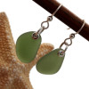 Perfect beach found olive green sea glass pieces set in a simple sterling silver setting.