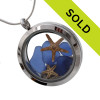 Tiny pieces of rare  Blue sea glass combined with 2 starfish in a stainless steel silver locket. Sorry this locket has sold!