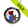 Red , white and blue sea glass are combined with a real baby starfish in this stainless steel locket necklace.