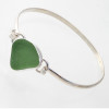 Beautiful vivid seafoam green sea glass set in fine and sterling silver on a silver half round bangle.