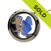 Genuine blue sea glass combined with two baby starfish, a tiny shell and real beach sand in this stainless steel locket.
