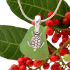 Beach found green sea glass is combined with a solid sterling sea turtle charm and presented on an 18 Inch solid sterling snake chain.
