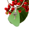 Beach found green sea glass is combined with a solid sterling palm tree charm and presented on an 18 Inch solid sterling snake chain.