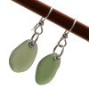 A perfect match of beach found UNALTERED sea glass set on fishook earwires. A lovely pair of earrings for any time of year!