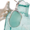 A beautiful thick piece of aqua green sea glass set for a necklace in our Original Sea Glass Bezel© setting THIS IS THE EXACT PENDANT YOU WILL RECEIVE!