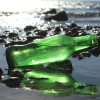 Many green sea glass pieces started out as beer and wine bottles broken on the beach and worn by the sea for many years. All of our sea glass is 100% beach found and not shaped by artificial means.