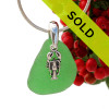 Beach found green sea glass is combined with a solid sterling lobster charm and presented on an 18 Inch solid sterling snake chain.