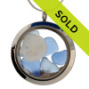 A beautiful and rare pieces of light blue sea glass combined with a real sandollar in this one of a kind sea glass locket necklace. Real beach sand from Florida completes your own personal beach on the go!