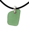 """Bright green sea glass set on a solid sterling cast bail  The sea glass necklace comes on our 18"""" solid black neoprene necklace. (SHOWN and included)"""
