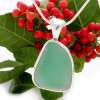 A nice piece of aqua green sea glass in an elegant and versatile setting.  Done in our Deluxe Wire Bezel© setting that leaves both front and back open for maximum color. Fully Reversible!