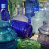 Many sea glass pieces originate from old bottles and jars broken and tossed into the sea.