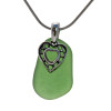 A perfect piece of natural green sea glass set on a solid sterling hand cast bail with a sterling silver heart in hearts charm. A perfect sea glass necklace for any sea glass lover!
