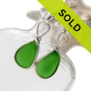 Vivid and stunning genuine green sea glass pieces set in our signature Original Wire Bezel© setting and presented on solid sterling posts.