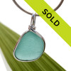 A beautiful thick piece of rvivid aqua green sea glass set for a necklace in our Original Sea Glass Bezel© setting THIS IS THE EXACT SEA GLASS PENDANT YOU WILL RECEIVE!