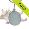 A large TOP QUALITY piece of baby or Carolina blue sea glass from England set in our Original Wire Bezel© pendant setting in silver. SORRY THIS PENDANT HAS BEEN SOLD!