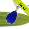 A blue sea glass necklace pendant in our Original Wire Bezel setting. This is a thicker piece of English Sea Glass. Sorry this pendant has been sold!