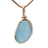 This is a stunning piece of beach found sea glass from England in a perfect bright blue warmed by the 14K goldfilled bezel.