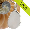 Large Pure white sea glass pendant in our sterling silver Original Wire Bezel© setting. This setting securely encases the sea glass without altering or damaging it!