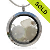 Pure white sea glass combined with a real sandollar, tiny beach shells and beach sand and brightened up with a ton of crystal white gems.  Great choice for an April Birthday! Sorry this sea glass jewelry selection has been sold!
