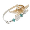 Aqua sea glass pieces and a handmade center bead of pure white set with sterling details on a thin solid sterling flat bangle bracelet.