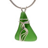 A stunning perfect vivid green sea glass piece found on the beaches of the Outer Banks of North Carolina.