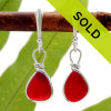 Petite Vivid red sea glass earrings set in our Original Wire Bezel© in silver. We only do one or two pair of red sea glass earrings a year when our stock permits. This is the EXACT One of a Kind pair you will receive! SORRY THIS PAIR OF SEA GLASS EARRINGS HAS BEEN SOLD!
