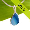 An amazing combination of vivid mixed light and medium blue in this very old English Sea Glass piece and set in our Original Wire Bezel© necklace pendant setting