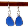 A lovely pair of beach found sea glass pieces in a sterling silver earring.