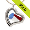 Our new heart lockets make this red, white and blue sea glass really shine! Genuine beach found glass.