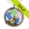 Genuine blue and lime green sea glass combined with a genuine fresh water stick pearl, a tiny starfish and real beach sand in this JUMBO 35MM stainless steel locket.  Pearl is the birthstone for June!