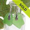 Huge pieces of green sea glass set on solid sterling with detailed flip flop charms. Sorry this pair has SOLD!