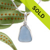 A carolina blue sea glass necklace pendant in our Original Wire Bezel setting. Sorry this pendant has sold!