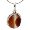 A beautiful larger piece of butterscotch mixed sea glass with a vivid amber center set for a necklace in our Original Sea Glass Bezel© in solid sterling silver setting.