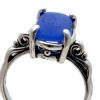 A perfect piece of blue beach found sea glass set in a solid sterling silver scroll ring.