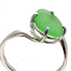 A vivid green natural sea glass piece set in an affordable simple silver ring.