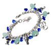 Aqua and Blue Sea Glass Bracelet. Amazing pale aqua real sea glass pieces from England and vivid cobalt blue sea glass from California are combined with solid sterling charms on a fully soldered bracelet. Charms include shrimp jellyfish, ray, seahorse and 2 sea turtles.